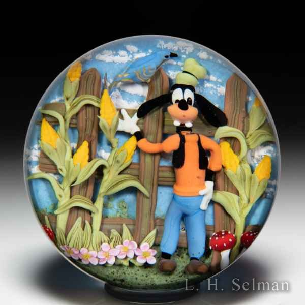 Clinton Smith 2019 Goofy and blue bird in a corn field paperweight. by Clinton Smith