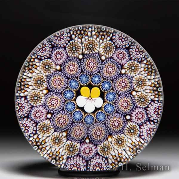 Mike Hunter 2020 close concentric millefiori and pansy glass paperweight. by Twists Glass Studio