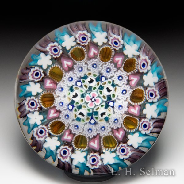 Damon MacNaught 2020 close concentric millefiori and pig silhouettes paperweight. by Damon MacNaught