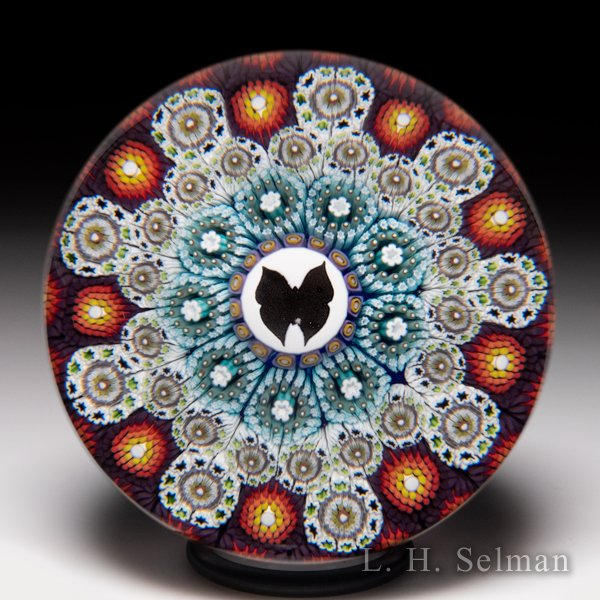 Mike Hunter 2011 patterned concentric millefiori and butterfly silhouette glass paperweight. by Twists Glass Studio