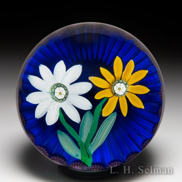 Mike Hunter 2015 two flowers and millefiori garland glass paperweight, by Michael Hunter and Colin Richardson. by Twists Glass Studio