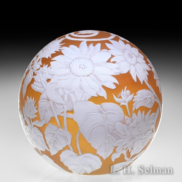 Cathy Richardson 2020 'Sunflowers' engraved amber and white surface design cameo glass paperweight. by Cathy Richardson