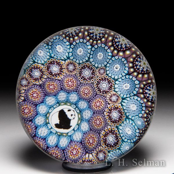 Mike Hunter 2020 off-set close concentric millefiori and panda picture cane glass paperweight. by Twists Glass Studio