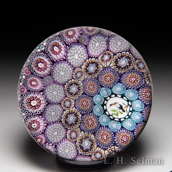 Mike Hunter 2020 off-set close concentric millefiori and toucan murrina glass paperweight. by Twists Glass Studio