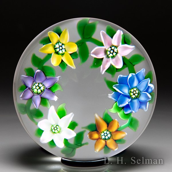 'J' Glass 1981 multi-colored clematis garland glass paperweight. by J Glass